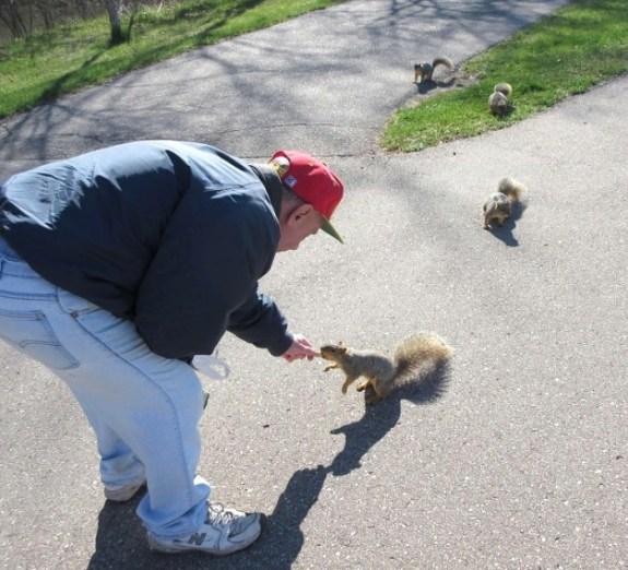 MIKE FEEDING SQUIRRELS