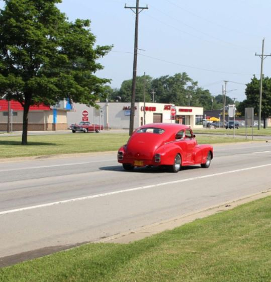 RED FUNNY CAR GOING