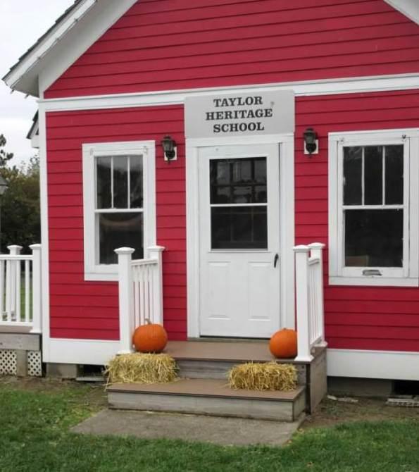 red schoolhouse with harvest decor.jpg