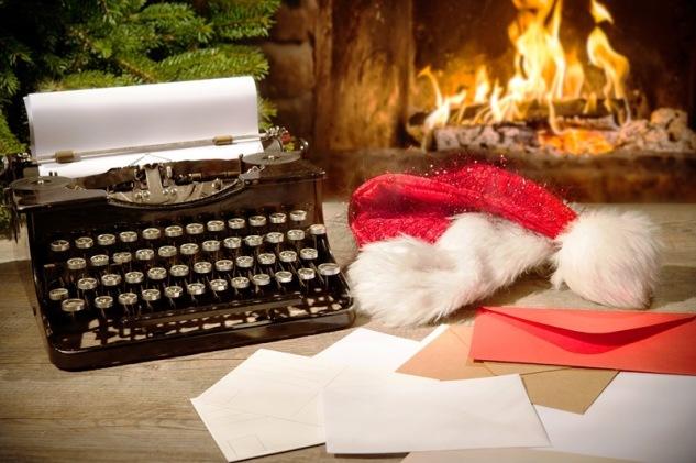 Old typewriter and Santa Claus hat on desk